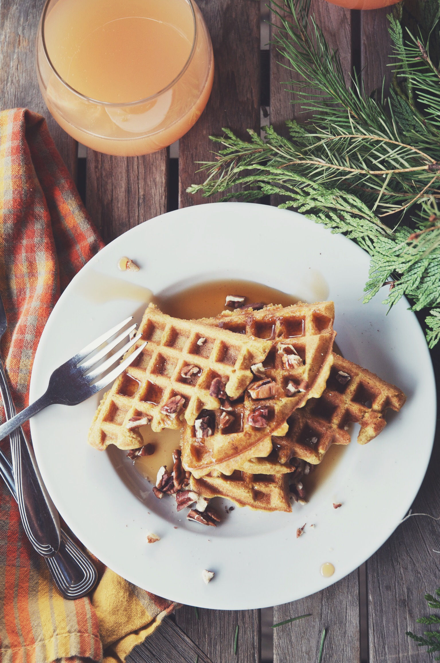 pumpkin oat waffles with mimosas and pine cuttings