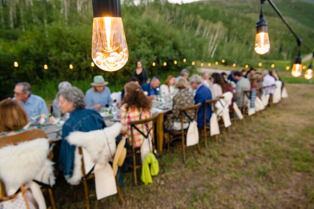 Lighting details above the long, 80-person dinner, design currated by Hygge Life.