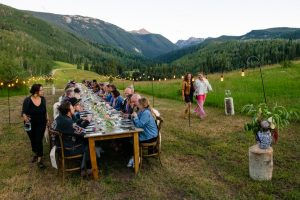The 80 guests have just been seated and are ready for the first course at the latest Colorado FIVE dinner at Knapp Ranch on a warm summer evening in August.